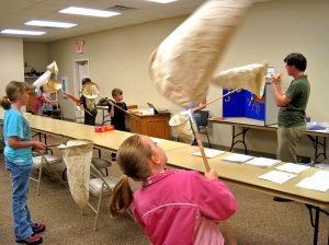 Teaching 4Hers in Kentucky how to sweep net for insects before going outdoors to get some specimens.